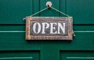Craft business sign open on green door
