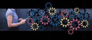 woman with different coloured cogs
